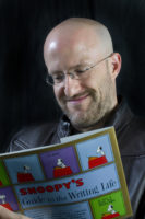 Jim reading a Snoopy book